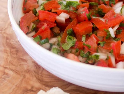 This Paleo and Whole30 Pico de Gallo is a quick and easy appetizer. Fresh tomatoes, onion, garlic, cilantro, limejuice and avocado oil and ten minutes are all you need. Vegan-, vegetarian-friendly.