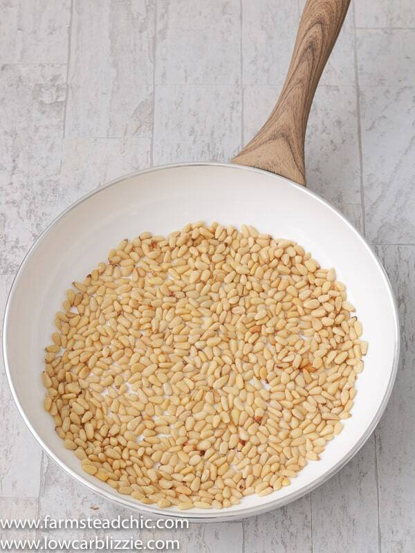 How to toast pine nuts! This super-quick, super-easy instructional post on how to toast pine nuts will bring your dreams of homemade keto pesto to life. All you need is a frying pan, a wooded spoon, and well, pine nuts!