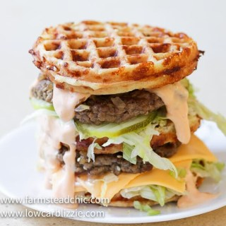 The perfect Chaffle bun, super thin, juicy, perfectly seasoned hamburger patty, crunchy dill pickles, shredded iceberg lettuce, American cheese and Thousand Island dressing make this Keto Big Mac Chaffle taste like the real thing without all the harmful additives and questionable ingredients.  #ketobigmac #bigmacchaffle #lowcarbbigmac #lowcarbburger #chaffle #farmsteadchic