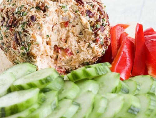 This Low Carb, Keto Pineapple Ham Cheese Ball is a guilt-free, flavorful appetizer for your holiday party. Freshly cooked country ham, toasted coconut, monk fruit, pineapple extract, roasted red peppers, chives, freshly shredded cheddar cheese and hot sauce all come together for a salty, sweet, spicy (low carb) spin on a traditional Hawaiian cheese ball. #farmsteadchic #cliftyfarm #ketocheeseball #lowcarbcheeseball #ketoappetizer #lowcarbappetizer