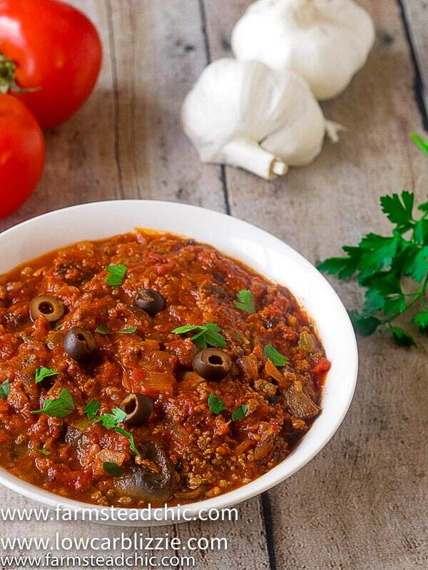 This Low Carb, Keto Pizza Soup with a Whole30 and Paleo option is the perfect warm and cozy meal for a chilly fall evening. With onions, green bell pepper, mushrooms, olives, marinara sauce and plenty of meat, it will satisfy your pizza craving without all the time and effort of those low carb pizza crusts.   www.farmsteadchic.com   #farmsteadchic #ketosoup #lowcarbsoup #ketopizza #lowcarbpizza #pizzasoup