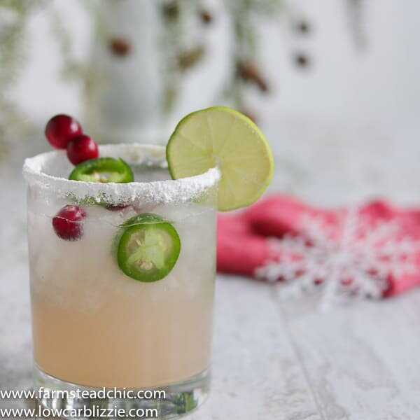 This Low Carb, Keto Spicy Cranberry Margarita is the perfect guilt-free holiday cocktail! Fresh cranberries and jalapeños add a special twist to the traditional margarita. Orange extract and a little water replace the traditional sugar-laden orange liqueur.| www.farmsteadchic.com #ketococktail #lowcarbcocktail #ketomargarita #lowcarbmargarita #spicymargarita #holidaymargarita #Christmascocktail