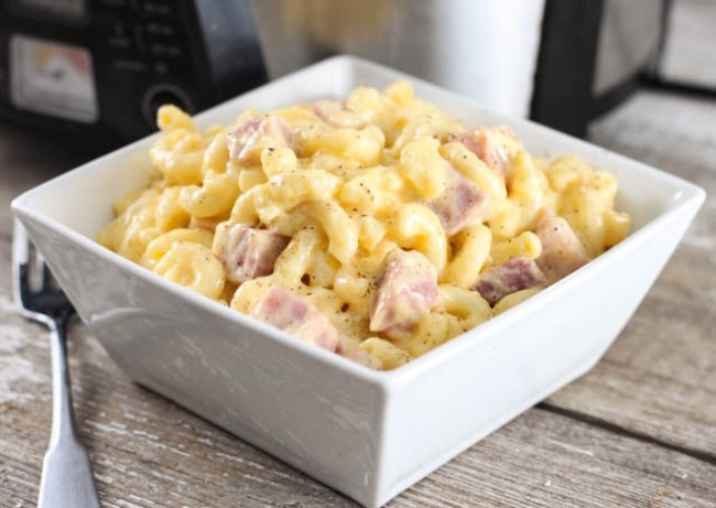 Everyone will ask for seconds when you make this recipe for Crock Pot Macaroni and Cheese with Ham. A yummy comfort food casserole.