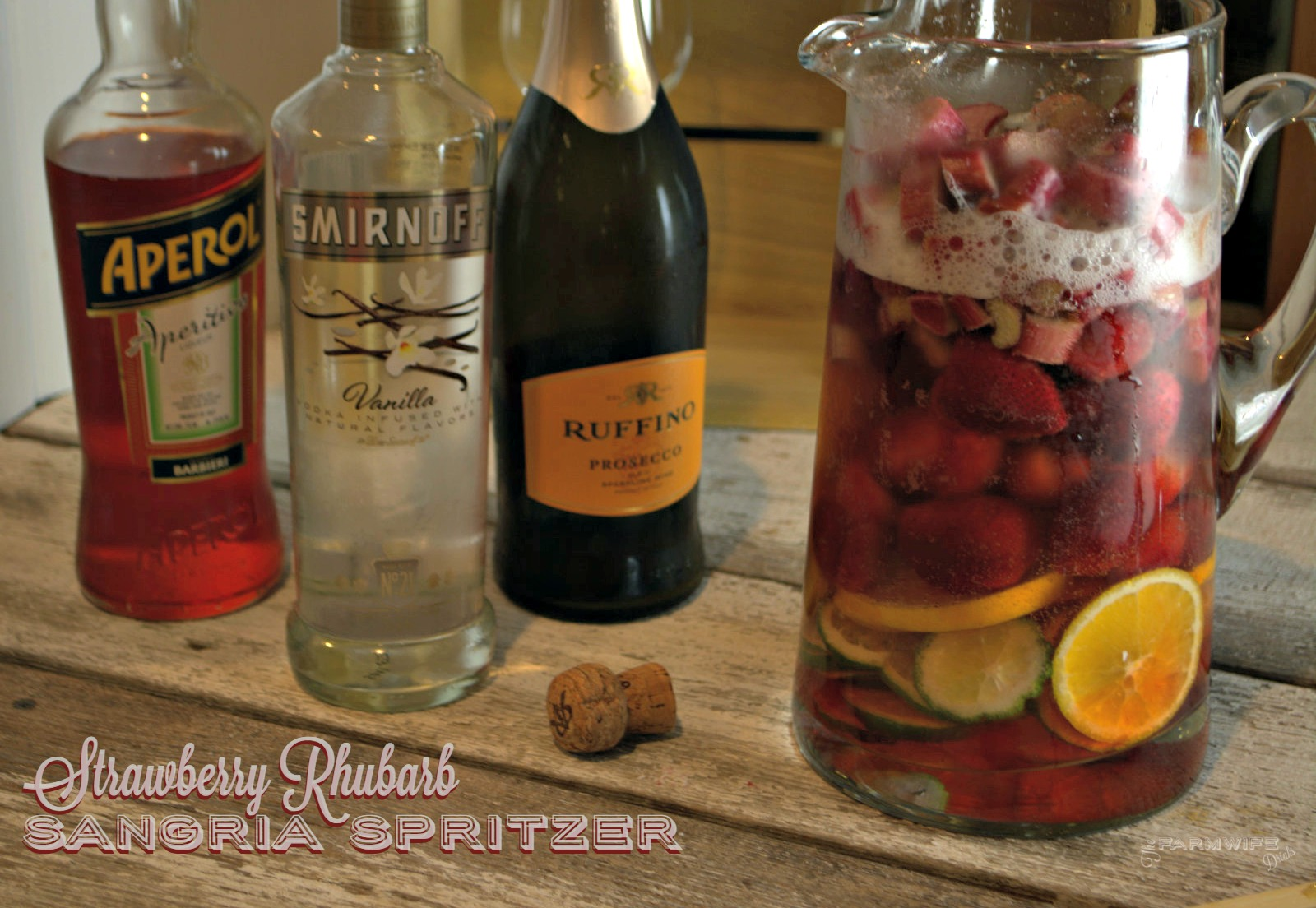 Aperol Sangria Spritzer combines the rhubarb, aromatic and orange flavors with prosecco and vanilla vodka to create early summer in a glass.