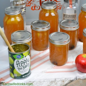 Apple pie moonshine combines apple cider and juice with apple pie filling with cinnamon sticks and vanilla with moonshine and vanilla vodka to create your new favorite fall liquor to drink. #Moonshine #AppleRecipes #ApplePie #Vodka