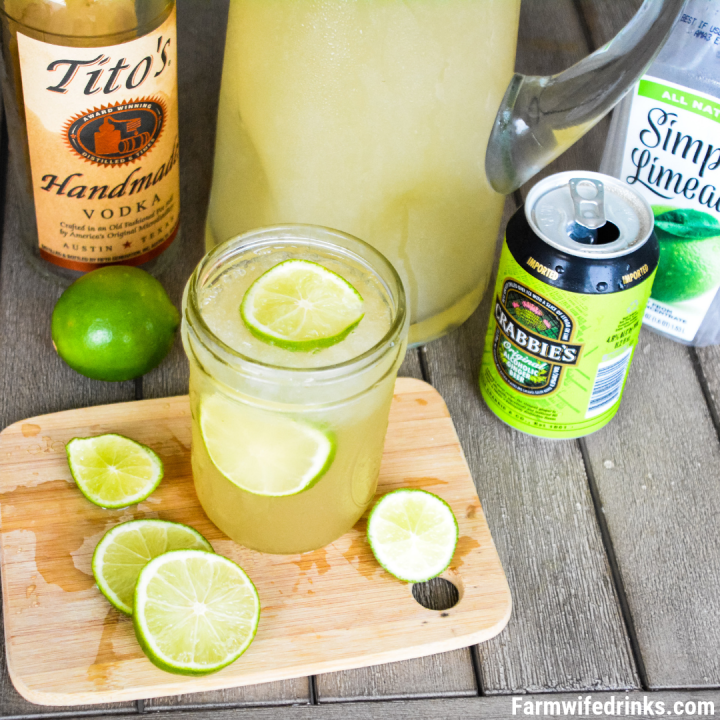 Moscow Mule Punch is the perfect large batch cocktail recipe combining limeade, ginger beer, and vodka great for tailgates, pool parties and BBQs.
