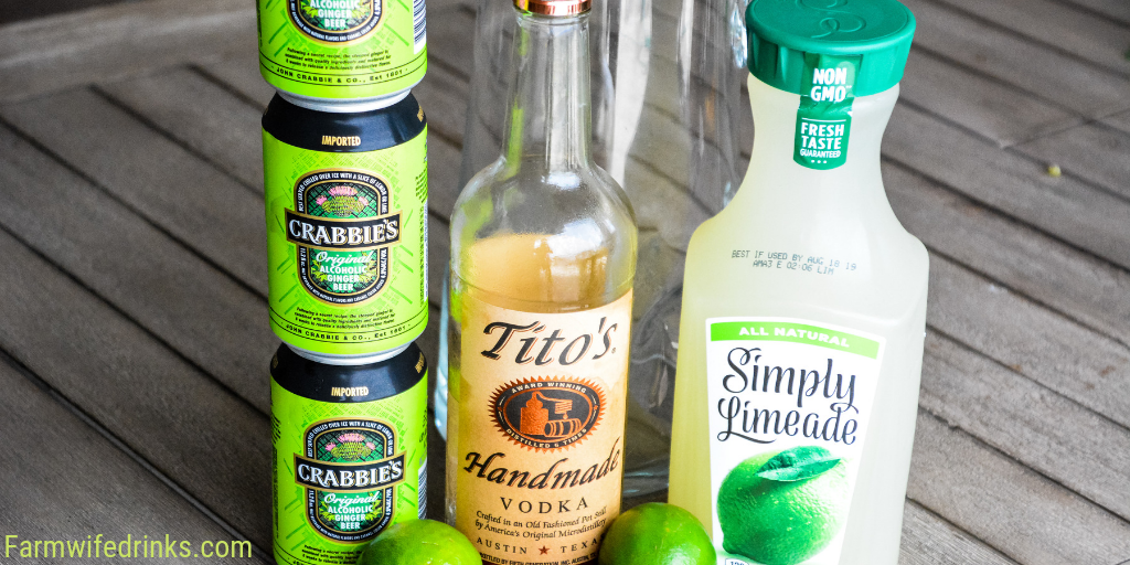 Moscow Mule Punch is the perfect large batch cocktail recipe combining limeade, ginger beer, and vodka great for tailgates, pool parties and BBQs. #Vodka #CocktailRecipe #Cocktails #MoscowMule #Beer #LargeBatchCocktails