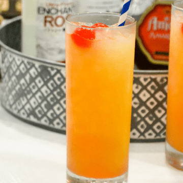 Yellow Hammer Slammer drink is strong cocktail perfect for tailgate parties and can be made by the pitcher or one at a time by stirring together vodka, rum, amaretto, pineapple juice, and OJ.