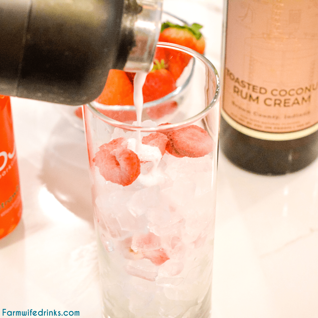 Pink drink cocktail is a yummy toasted coconut rum cream mixed with strawberries and sparkling water to make this delicious strawberry coconut cream rum cocktail.