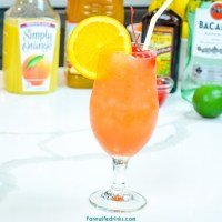 The New Orleans Hurricane Drink can be made at home with light and dark rum, passion fruit juice, orange juice, and grenadine. Top it off with a simple orange slice and maraschino cherries.