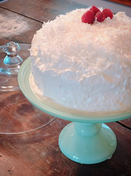 Coconut Icebox Cake from Farmwife Feeds -a traditional refrigerator cake and a poke cake all together that is better when you make it a day ahead. #coconut #cake #pokecake
