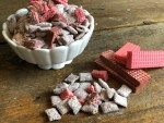 Chocolate Covered Strawberry Puppy Chow from Farmwifefeeds is a great twist on an easy snack. #chocolate #puppychow #snack #chexmix