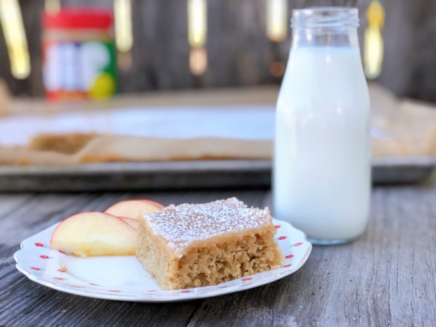 Peanut Butter Sheet Cake from Farmwife Feeds is a homemade cake and icing that will feed a crowd. #peanutbutter #cake #homemade