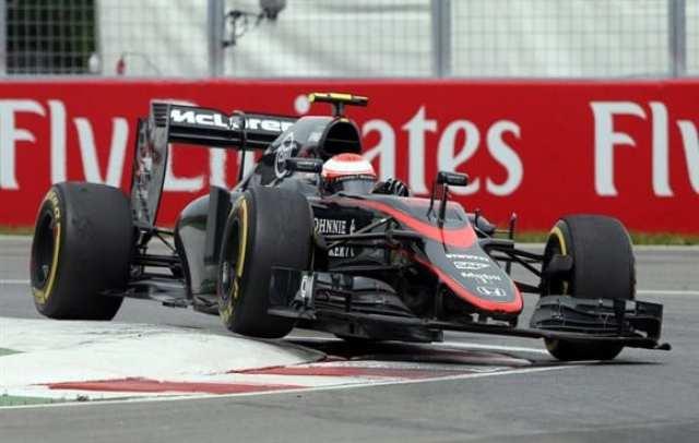 Button (foto) e Alonso sofreram com os problemas da McLaren em Montreal (AP)