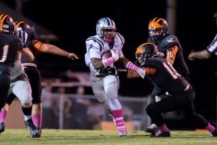 Amon Johnson breaks a run against the Lenoir City defense on 10/14. PHOTO CREDIT: Carlos Reveiz, CRFOTO.com