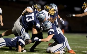 A feel of Admirals tackle the McMinn runner on 11/4. PHOTO CREDIT: Carlos Reveiz, CRFOTO.com