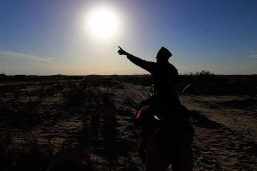 Riding a camel in the Kashgar desert