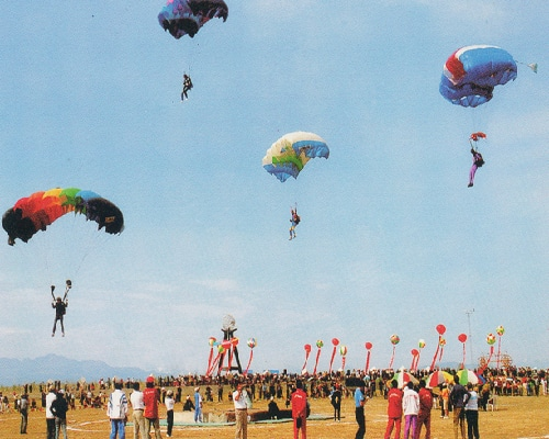 Parachute festival at Xinjiang's Center of Asia Monument