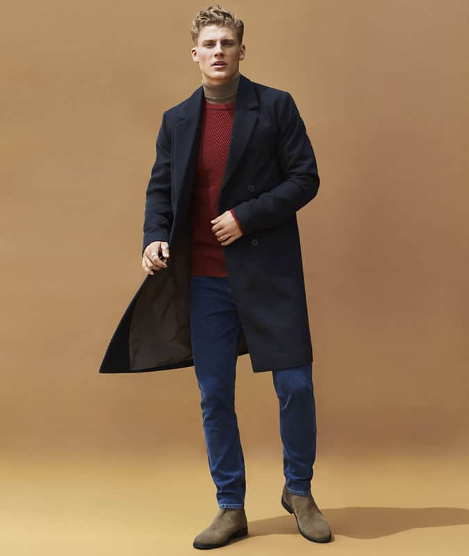 layering a roll neck under a crew neck