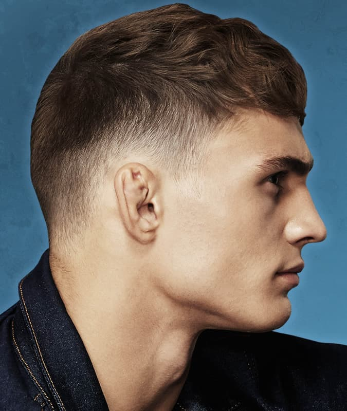 Men's short cropped haircut with a taper fade