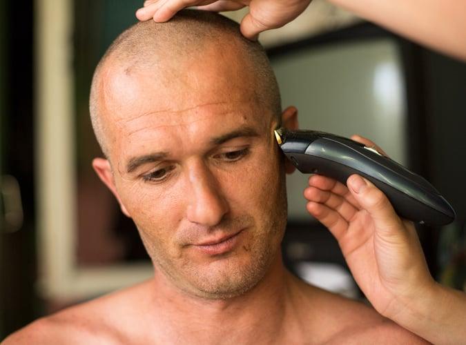 Shaving a mans head