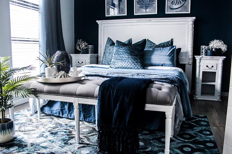 quarto com parede e roupa de cama na cor preta
