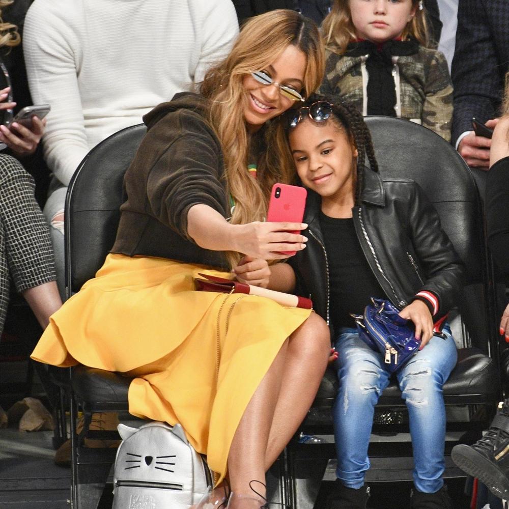 Beyoncé e Blue Ivy em evento.
