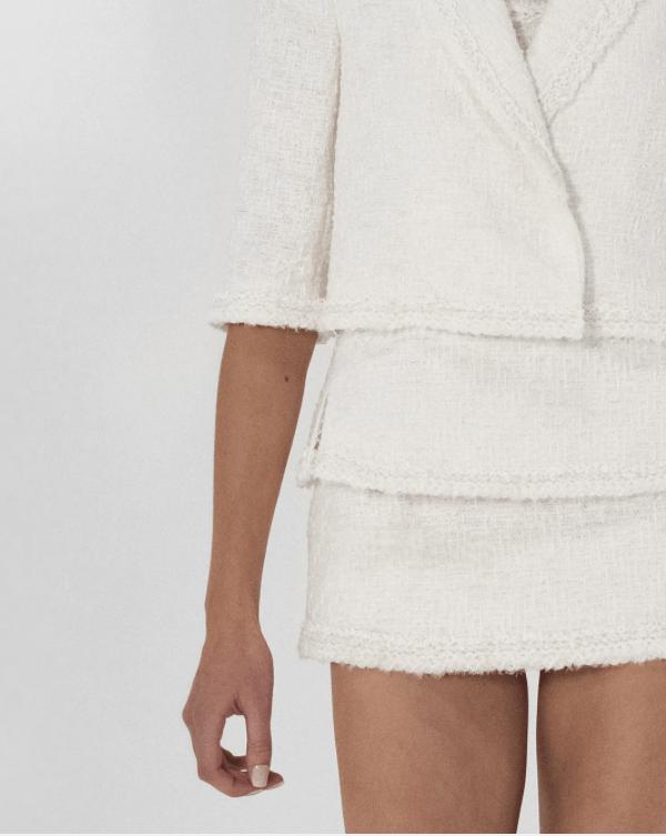 Modelo veste conjunto alfaiataria de tricô