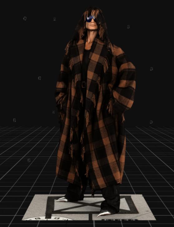 Modelo usa poncho coat xadrez com franjas