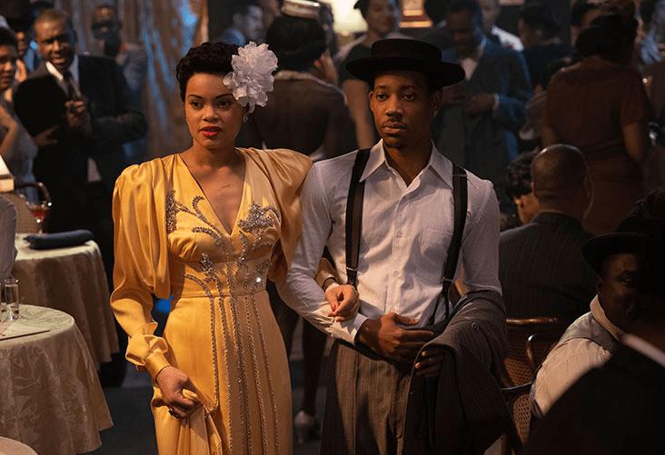 Prada veste Andra Days em filme sobe Billie Holiday com figurino cetim amarelo e pedrarias