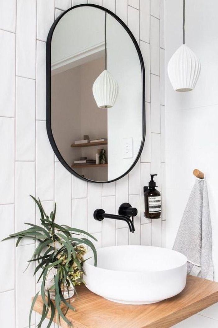 Banheiro minimalista com cuba redonda.