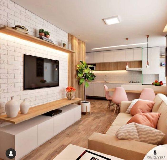 Ambientes integrados em casa de mulher.