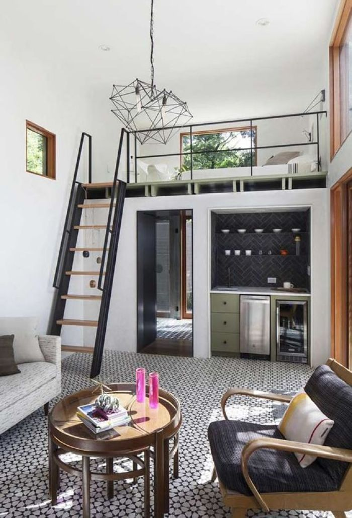 Casa loft simples preta e branca.