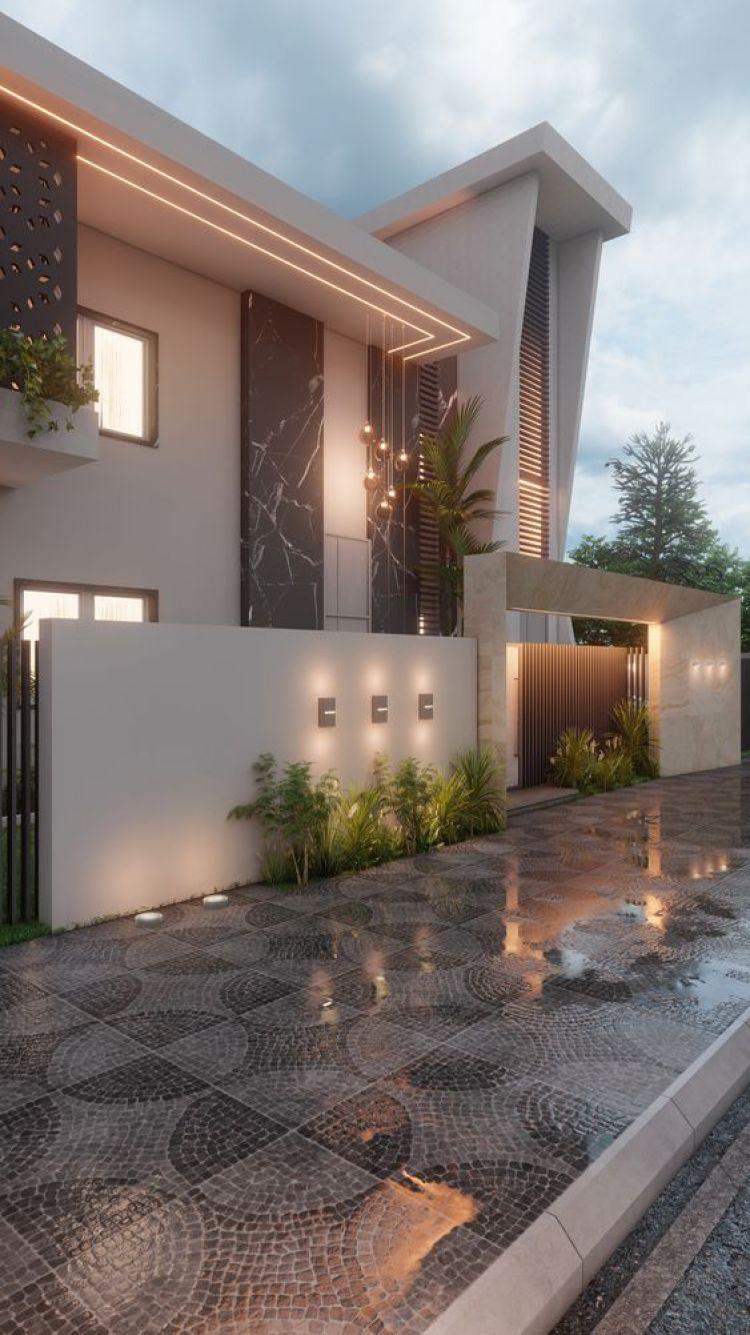 Muro residencial iluminado com jardim.