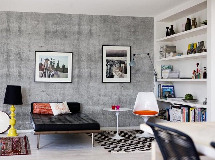 Fonte: Pinterest  Foto de sala de estar com parede de cimento queimado