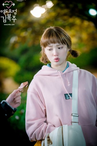 Weightlifting Fairy Kim Bok Joo wearing a Pink Hoodie