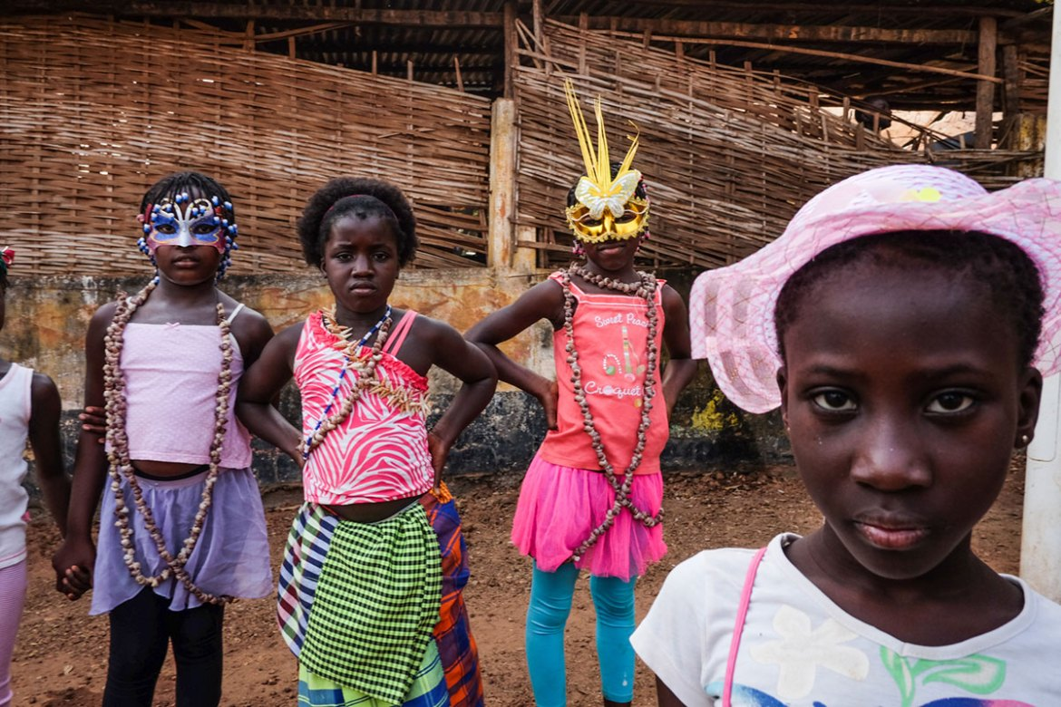 Young girls in Bissau prepare to take part in  the youth parade, part of the former Portuguese colony's carnival celebrations. [Ricci Shryock/Al Jazeera]