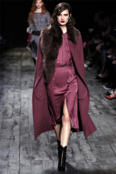 A look from Nina Ricci's fall 2012 show features a defined waist and evokes 30s screen glamour for today