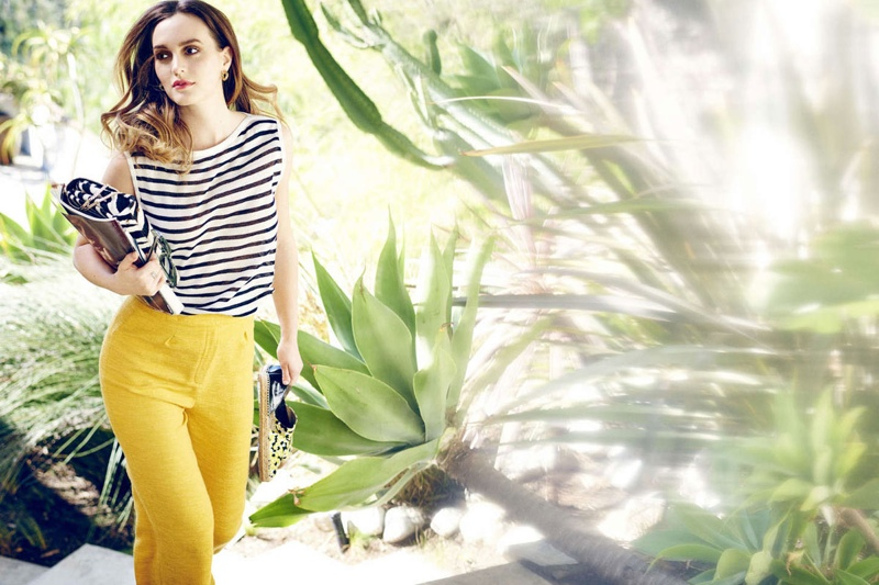 Photographed in the outdoors, Leighton dons the Dreya and Alba from Jimmy Choo