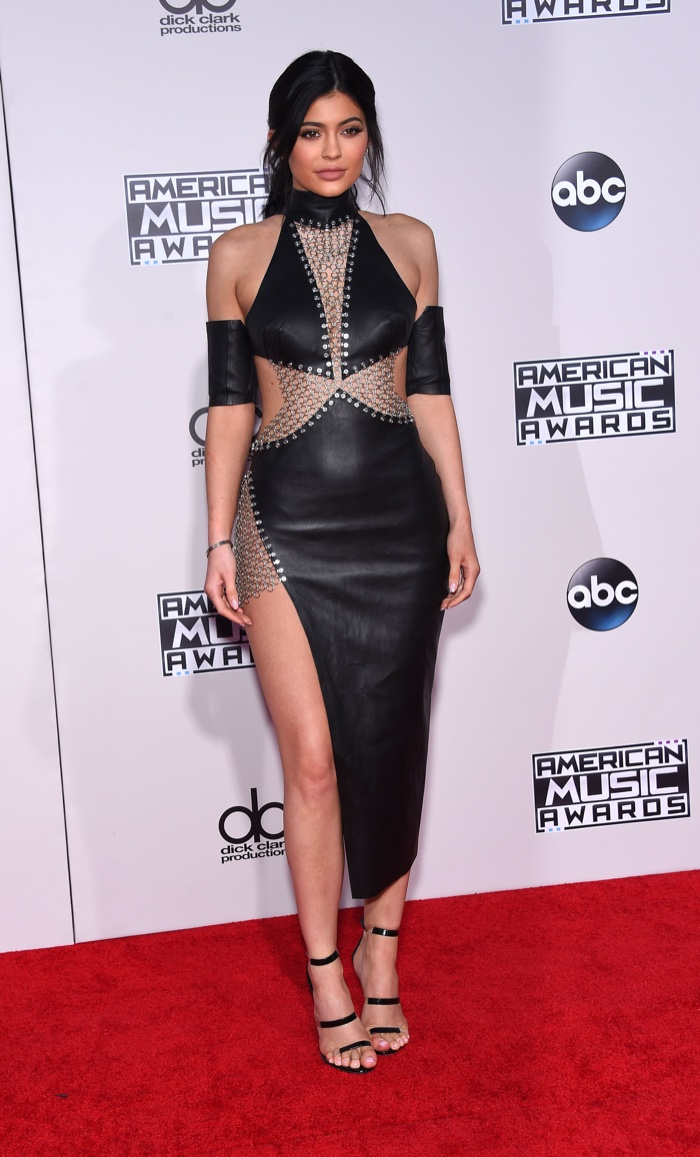 Kylie Jenner attends the 2015 American Music Awards, flaunting plenty of skin in a black leather and chainmail Brian Hearns dress. Photo: DFree / Shutterstock.com