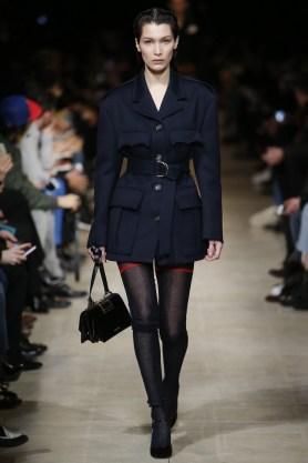 Bella Hadid walks the runway at Miu Miu's fall-winter 2016 show during Paris Fashion Week