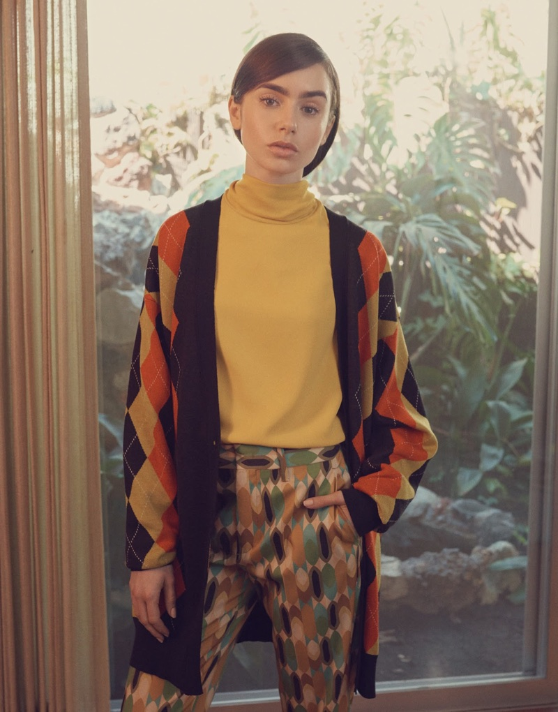 Lily Collins wears Stella McCartney argyle cardigan, Joseph blouse and Prada cropped pants