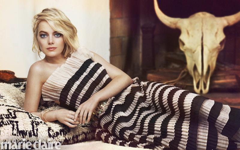 Lounging in style, Emma Stone wears striped Chanel dress