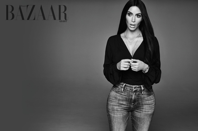Captured in black and white, Kim Kardashian wears Paige top and Good American jeans