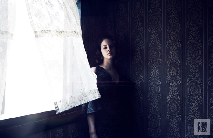 In the shadows, Lana Del Rey wears Maria Lucia Hohan dress