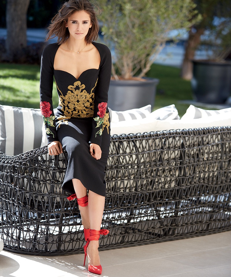 Actress Nina Dobrev wears Dolce & Gabbana embroidered dress and Christian Louboutin pumps