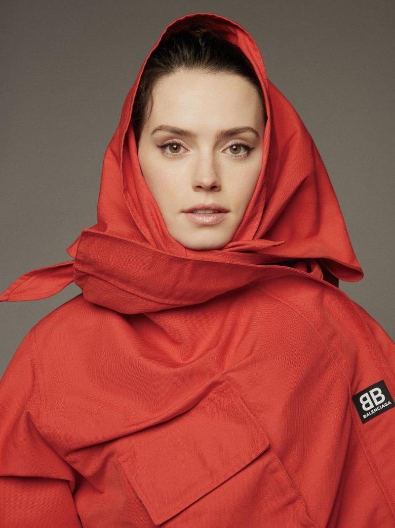 Actress Daisy Ridley poses in red Balenciaga coat