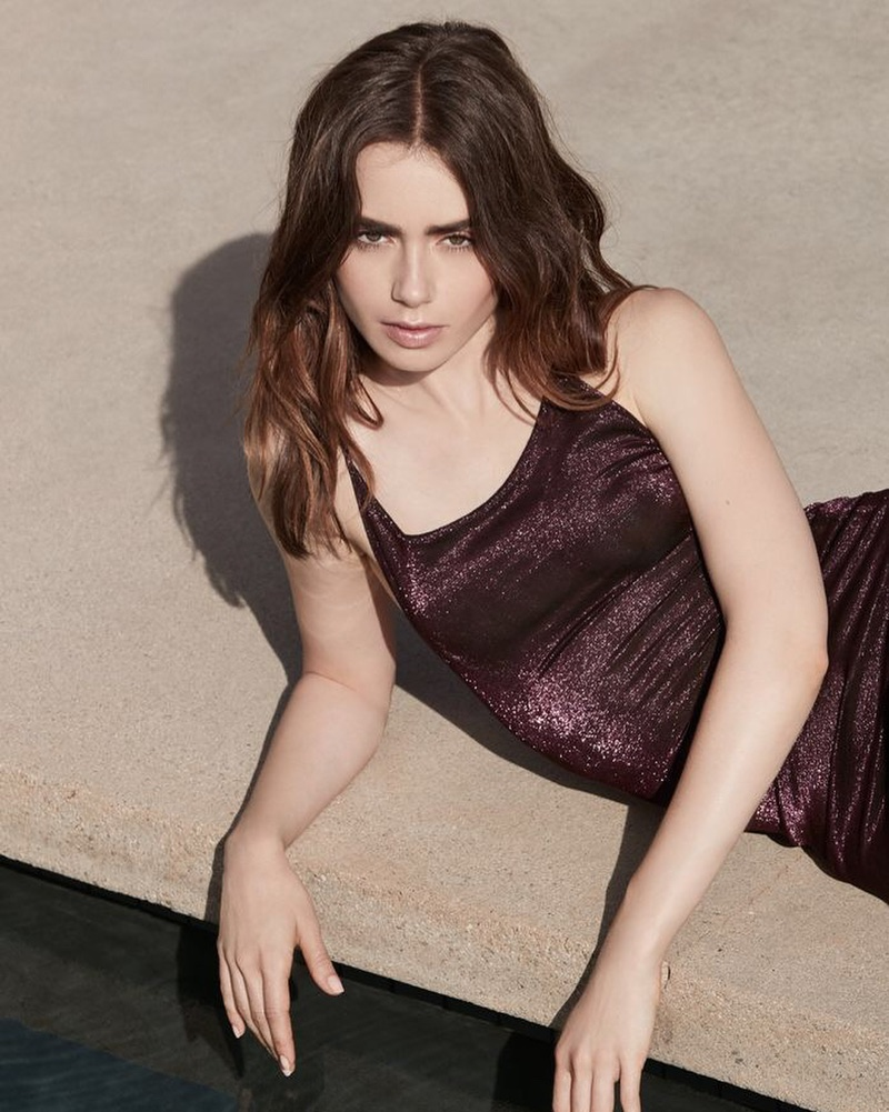 Actress Lily Collins wears purple dress