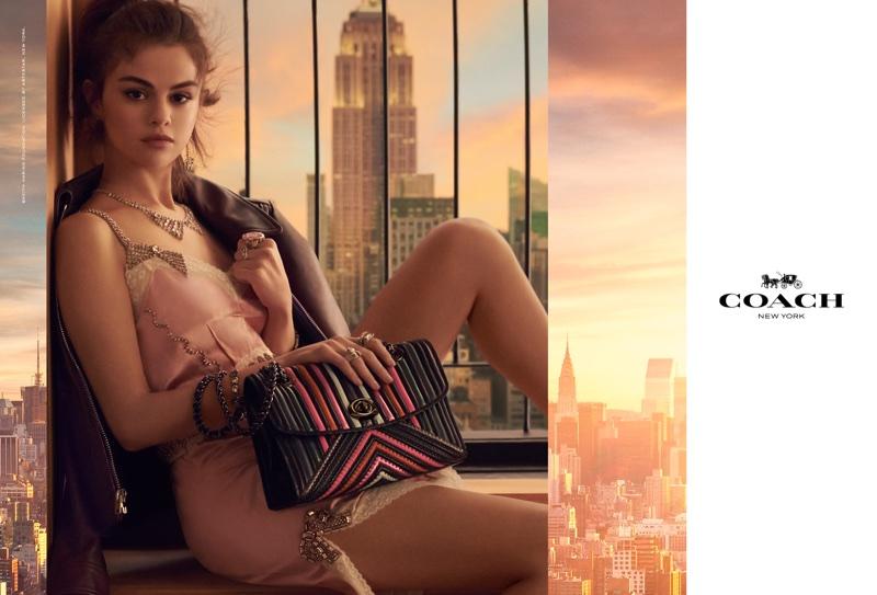 Singer Selena Gomez wears a slip dress in Coach's spring-summer 2018 handbag campaign