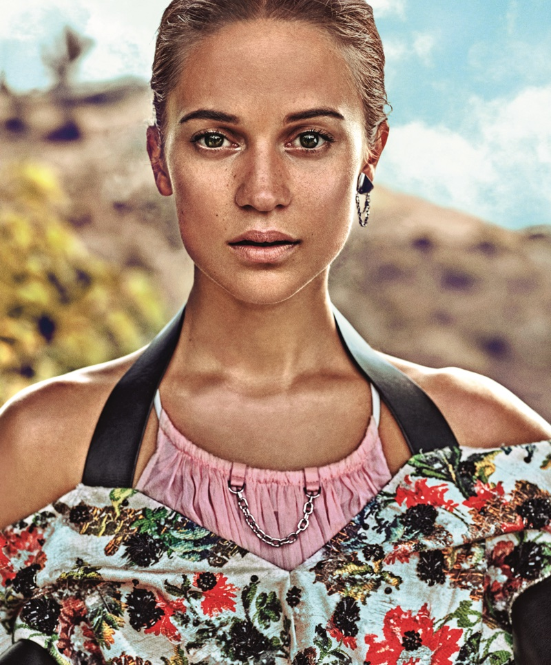 Ready for her closeup, Alicia Vikander wears Louis Vuitton blouse, dress and earring